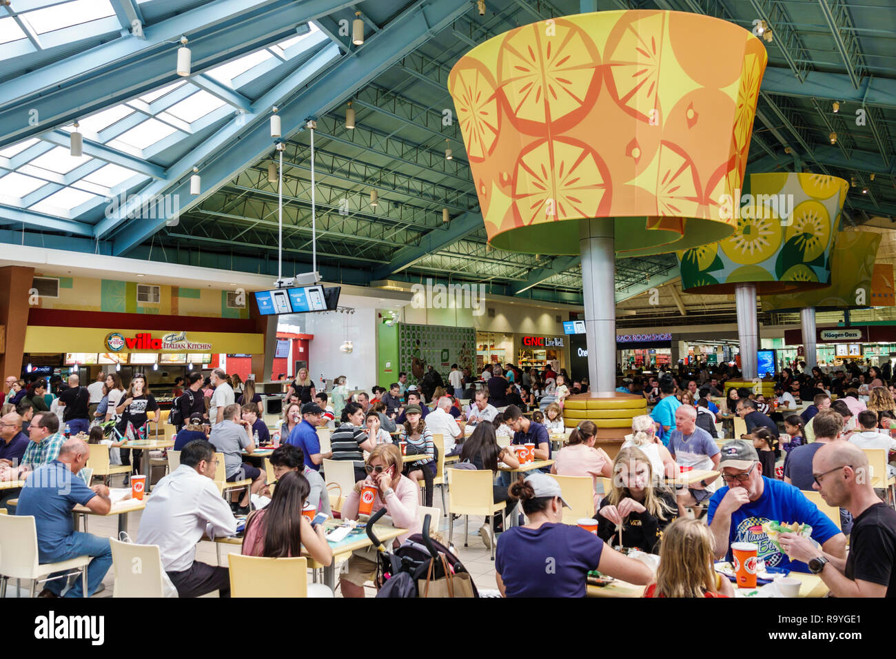 Fort Ft. Lauderdale Florida Sunrise Sawgrass Mills Mall shopping food court tables families restaurant - Stock Image