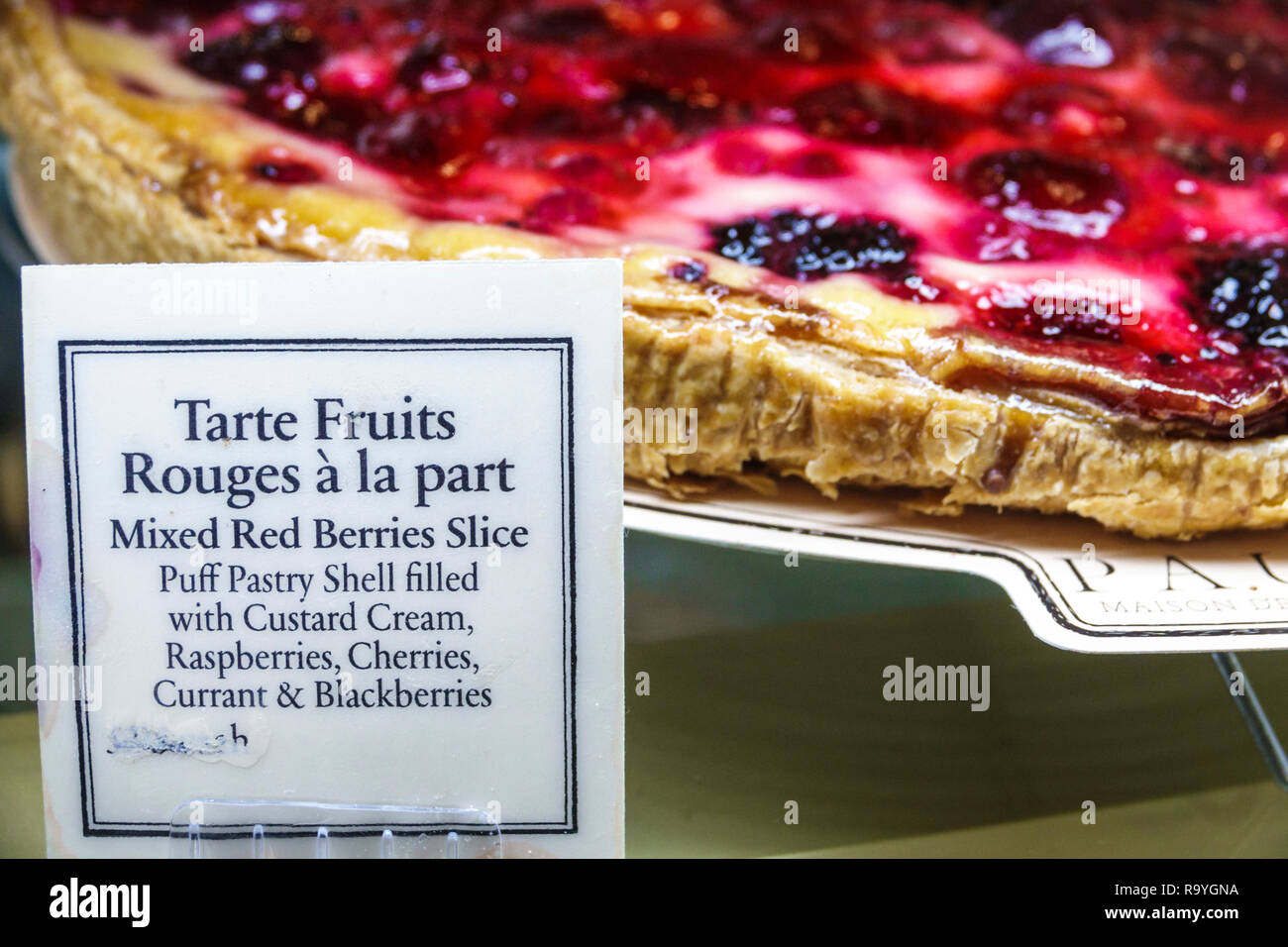 Fort Ft. Lauderdale Florida Sunrise Sawgrass Mills Mall Paul Maison de Qualite Bakery restaurant inside display sale mixed redberry slice dessert - Stock Image