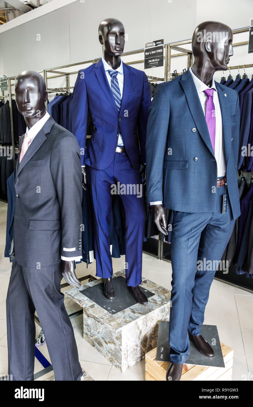Fort Ft. Lauderdale Florida Sunrise Sawgrass Mills Mall shopping Saks Fifth Avenue Off 5th inside display sale mannequins men's suits blue gray - Stock Image