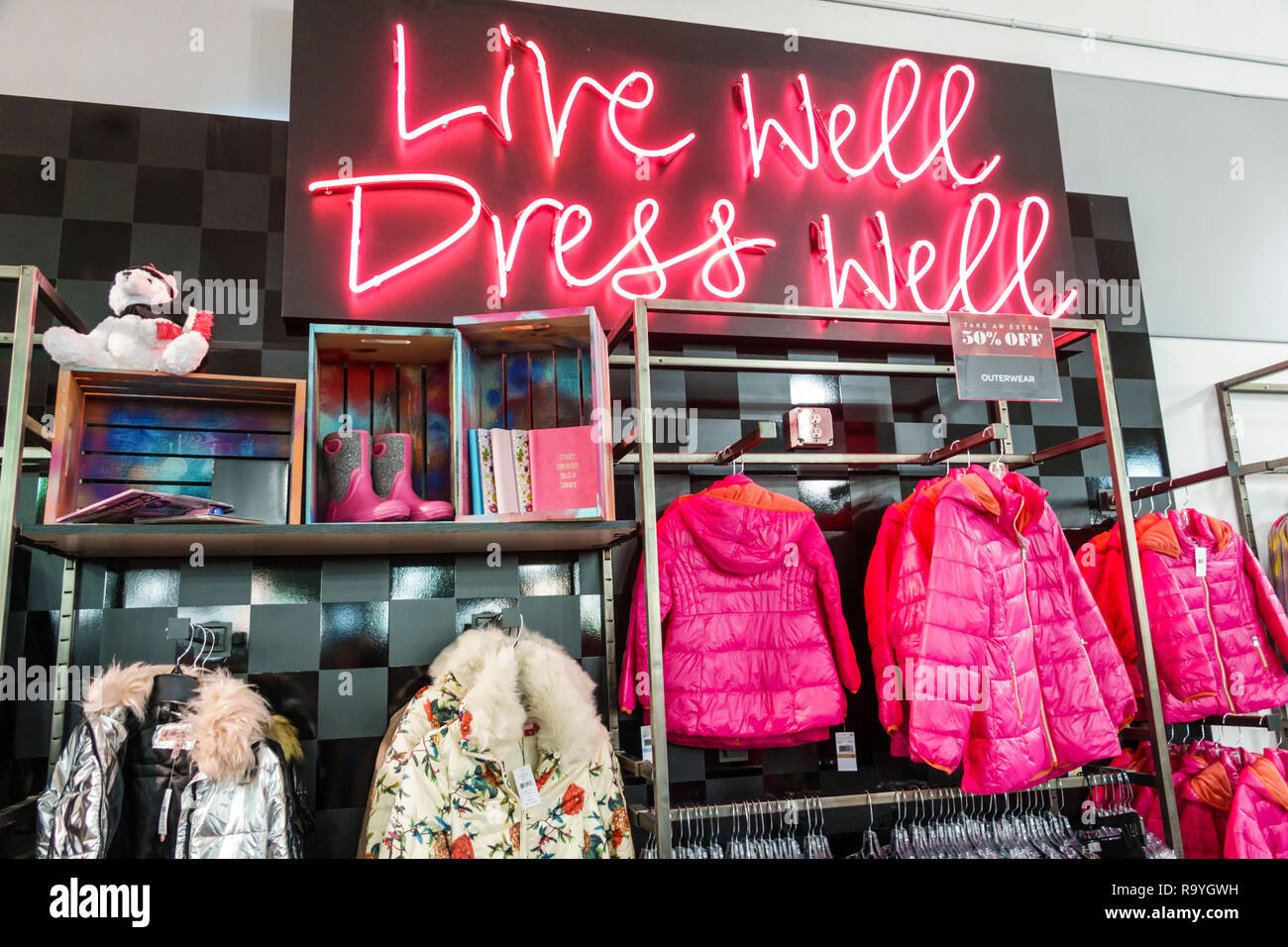 Fort Ft. Lauderdale Florida Sunrise Sawgrass Mills Mall shopping Saks Fifth Avenue Off 5th inside display sale coats clothing neon sign - Stock Image