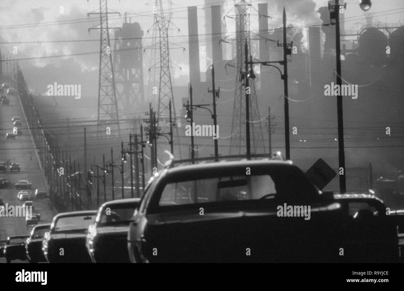 Smoke billows from industrial smokestacks in America as pollution from cars adds to the deadly mix Stock Photo