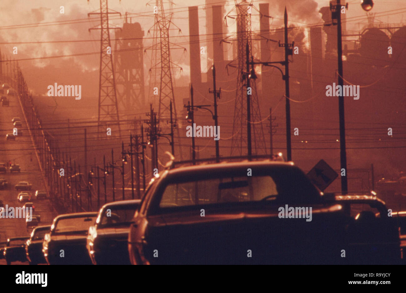 Smoke billows from industrial smokestacks in America as pollution from cars adds to the deadly mix - Stock Image