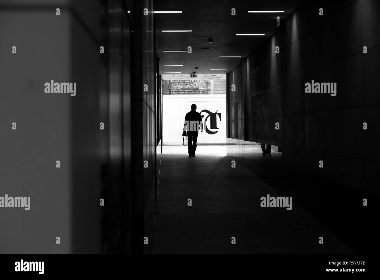 A photographer about to enter a shopping centre in Leeds which is against their policies. - Stock Image