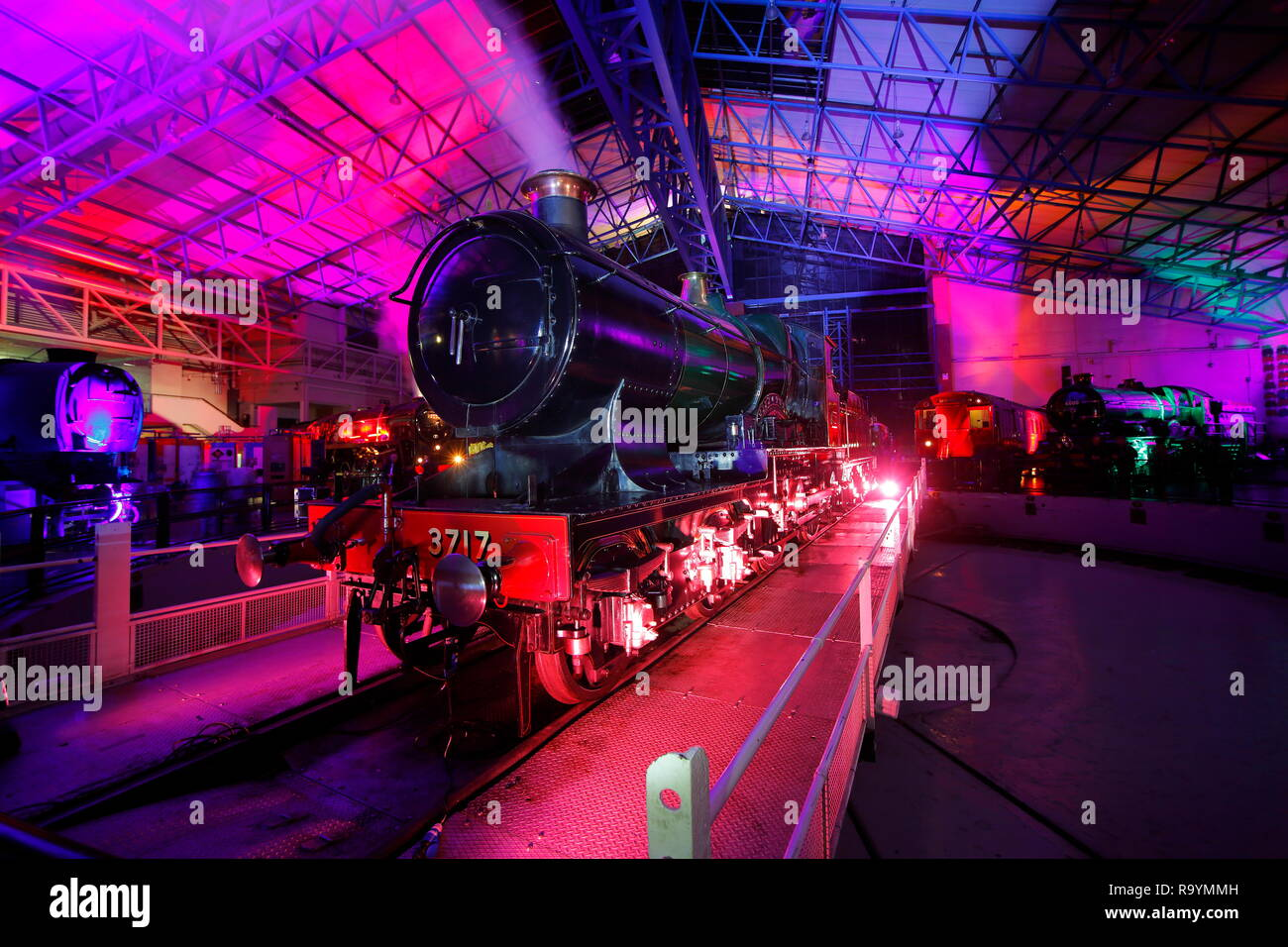 Engine 3717 City of Truro Steam Train at The National Railway Museum in York during an evening of illuminations - Stock Image