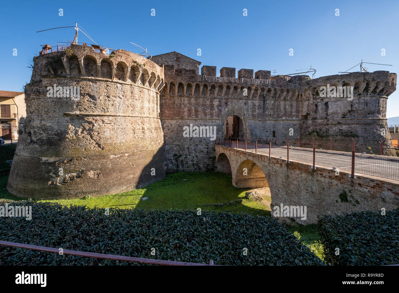 Porta Nuova (or Porta Salis) with the two Renaissance circular towers built in the XV-XVI century, is one of the gates to the medieval village of Coll Stock Photo