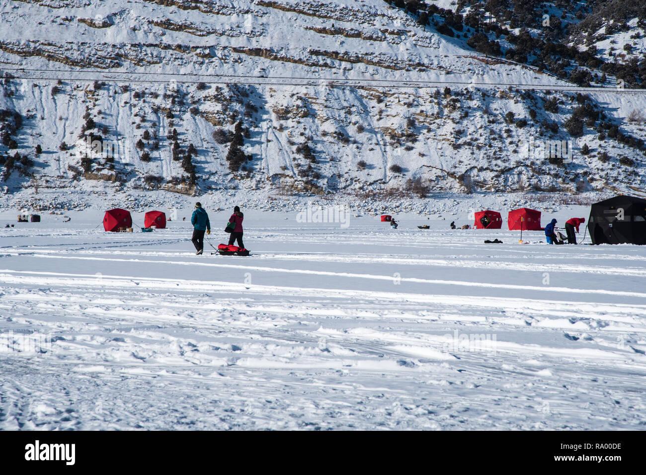 Ice fisherman on a frozen lake. - Stock Image