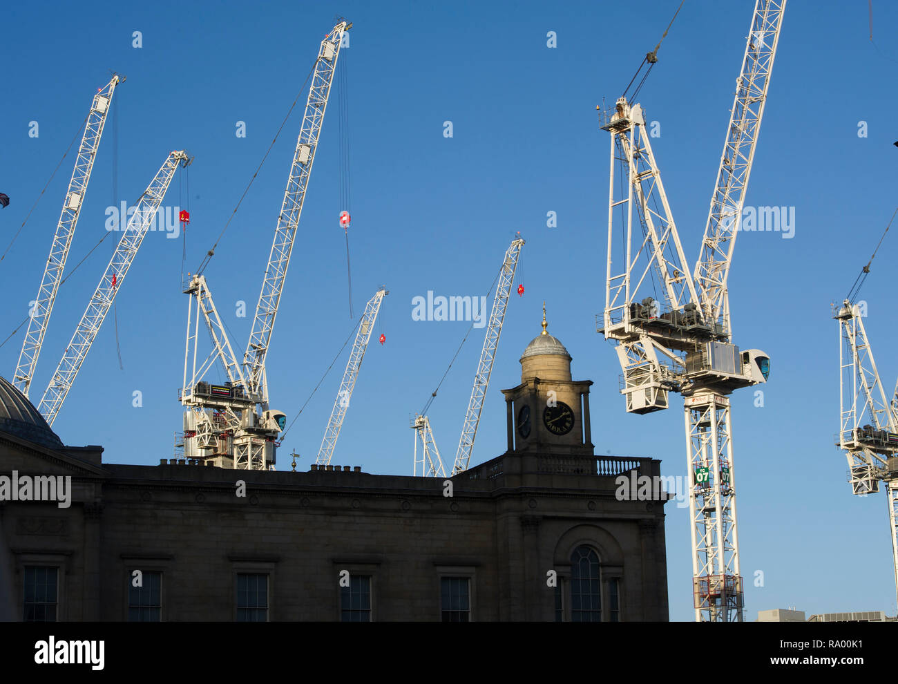 Tower cranes rise up from the St James centre development at the east end of Princes street, Edinburgh. - Stock Image