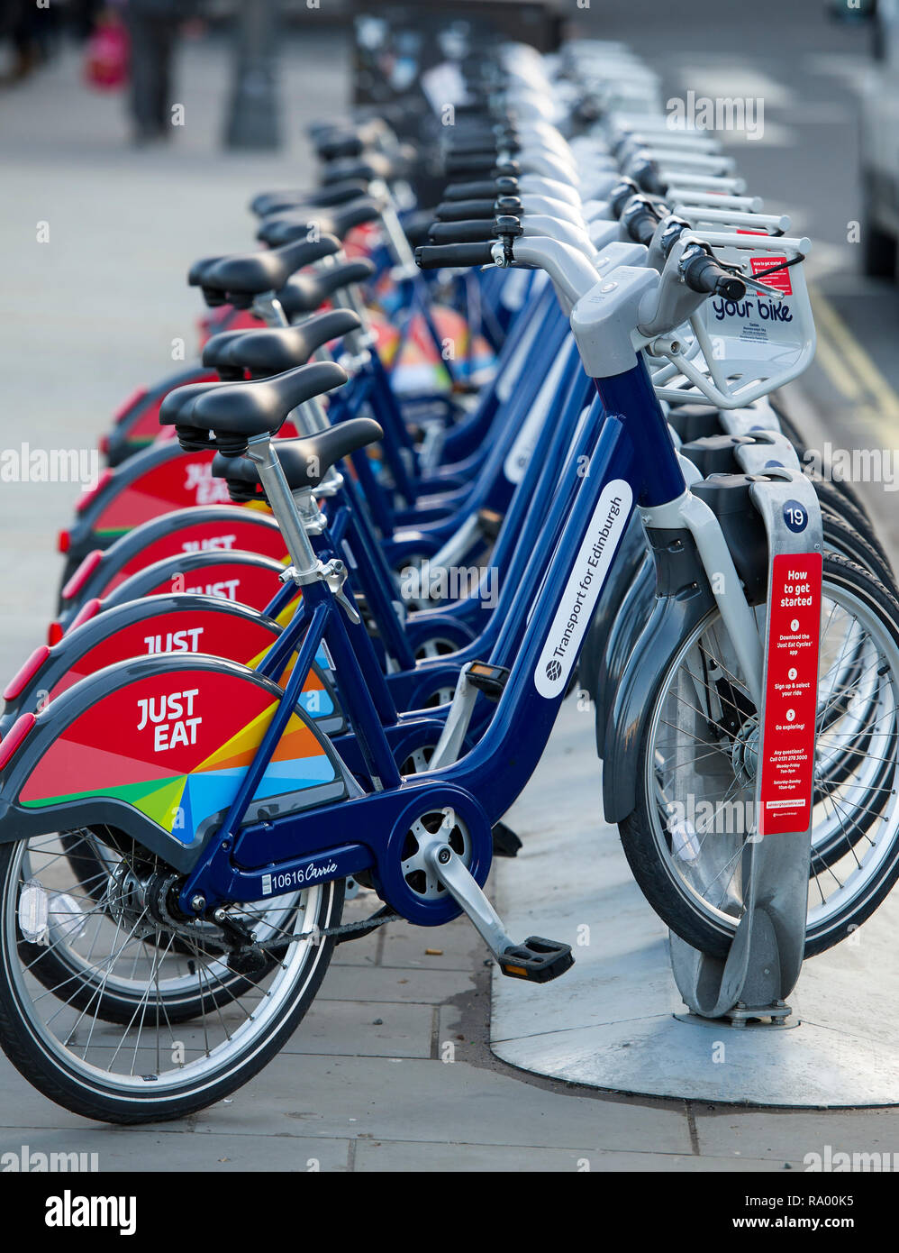 Just Eat sponsored bike hire part of the Transport for Edinburgh bicycle for hire network in the city centre. - Stock Image