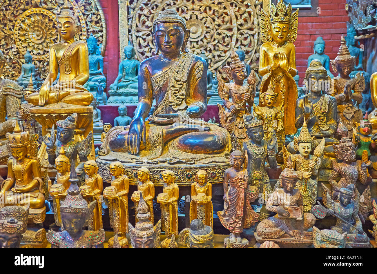 The wide range of scenic handmade Buddhist cult sculptures and statuettes in shape of Buddha, Nats (spirit deities), bhikkhu monks and mythic creature - Stock Image