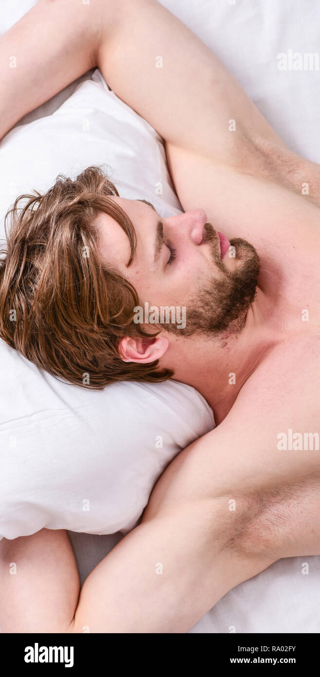 Expert tips on sleeping better. Bearded man sleeping face relaxing on pillow. How much sleep you actually need. Man handsome guy lay in bed. Get adequate and consistent amount of sleep every night. - Stock Image