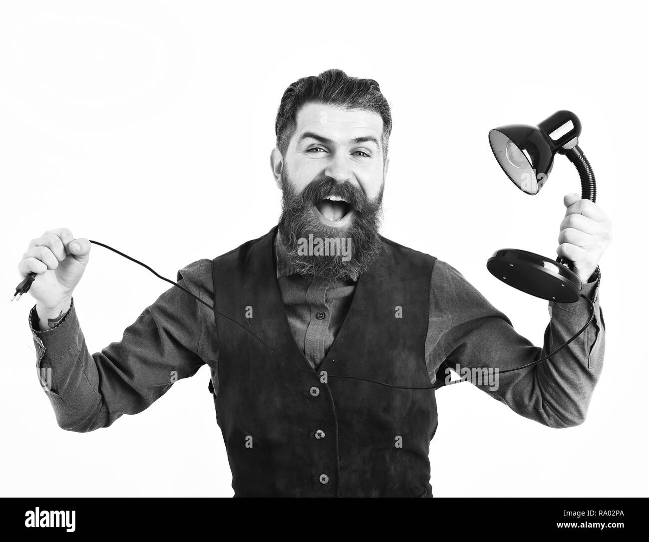 bearded man, long beard, brutal caucasian hipster with moustache holding table-lamp with happy face isolated on white background - Stock Image