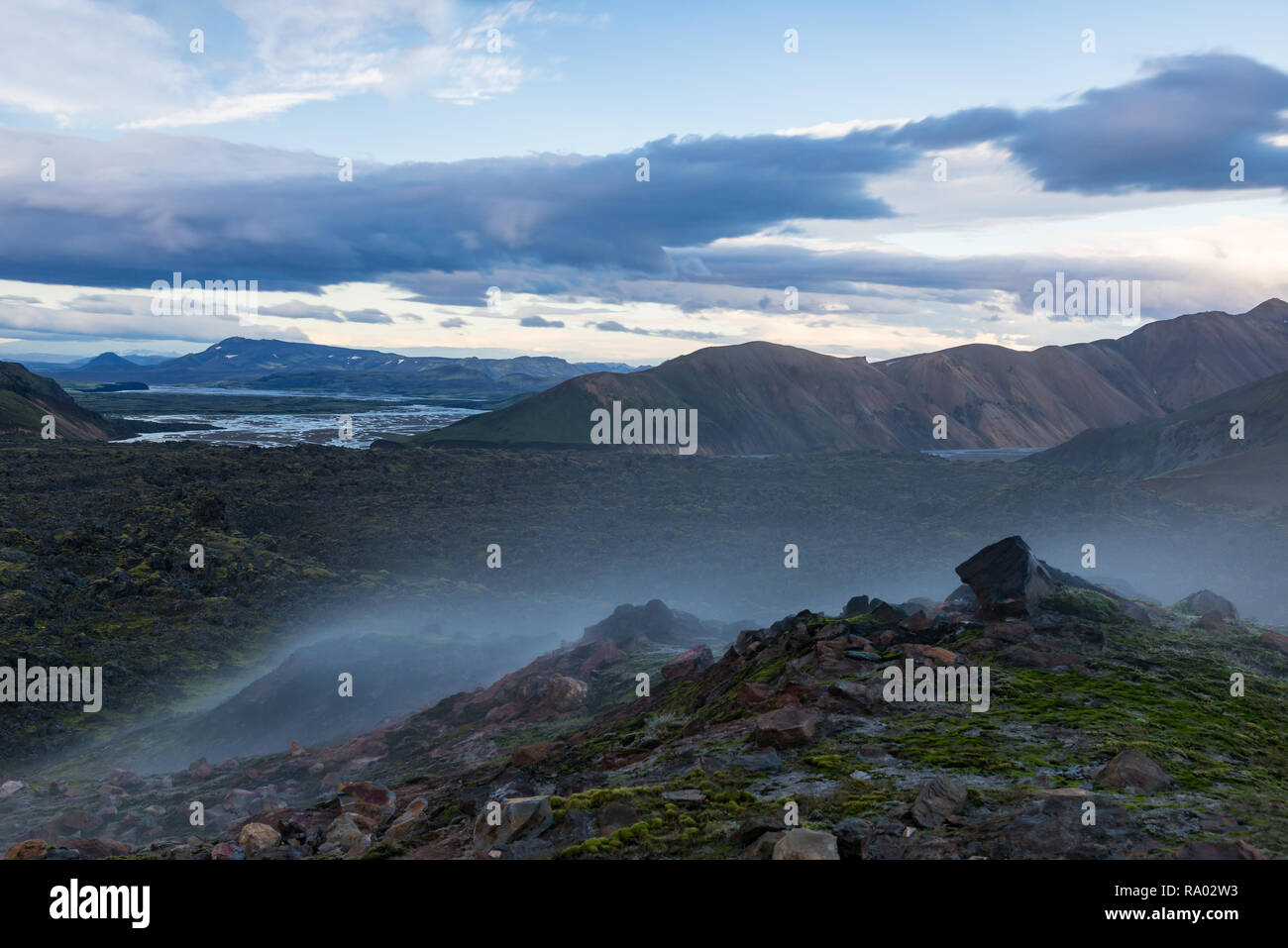 Mountains of Iceland, smoking fumaroles on foregroung - Stock Image