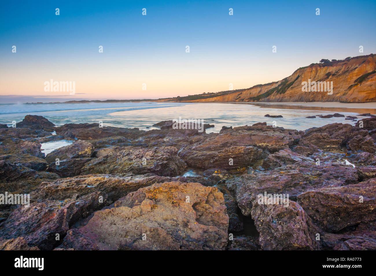 The cliffs of Anglesea Beach, Anglesea, Surf Coast Shire, Great Ocean Road, Victoria, Australia at dawn. - Stock Image