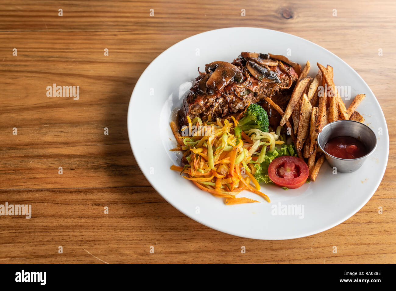 Gourmet Meatloaf with Wine Gravy, Vegetables and Hand Cut Fried Potatos - Stock Image
