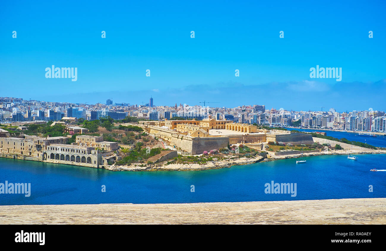 The view on the medieval star fort on Manoel Island and the modern coast of Gzira and Sliema resorts behind it from the top of St Michael's Bastion of - Stock Image