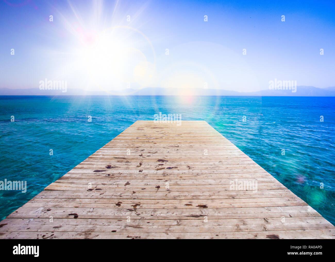 Idyllic water scene with wooden dock and Lake Tahoe - Stock Image