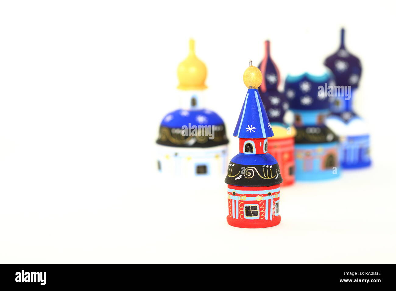 Set of wood painted cupola tower toy, orthodox towers toy, mausoleum toy, souvenir russian style isolated on white background - Stock Image