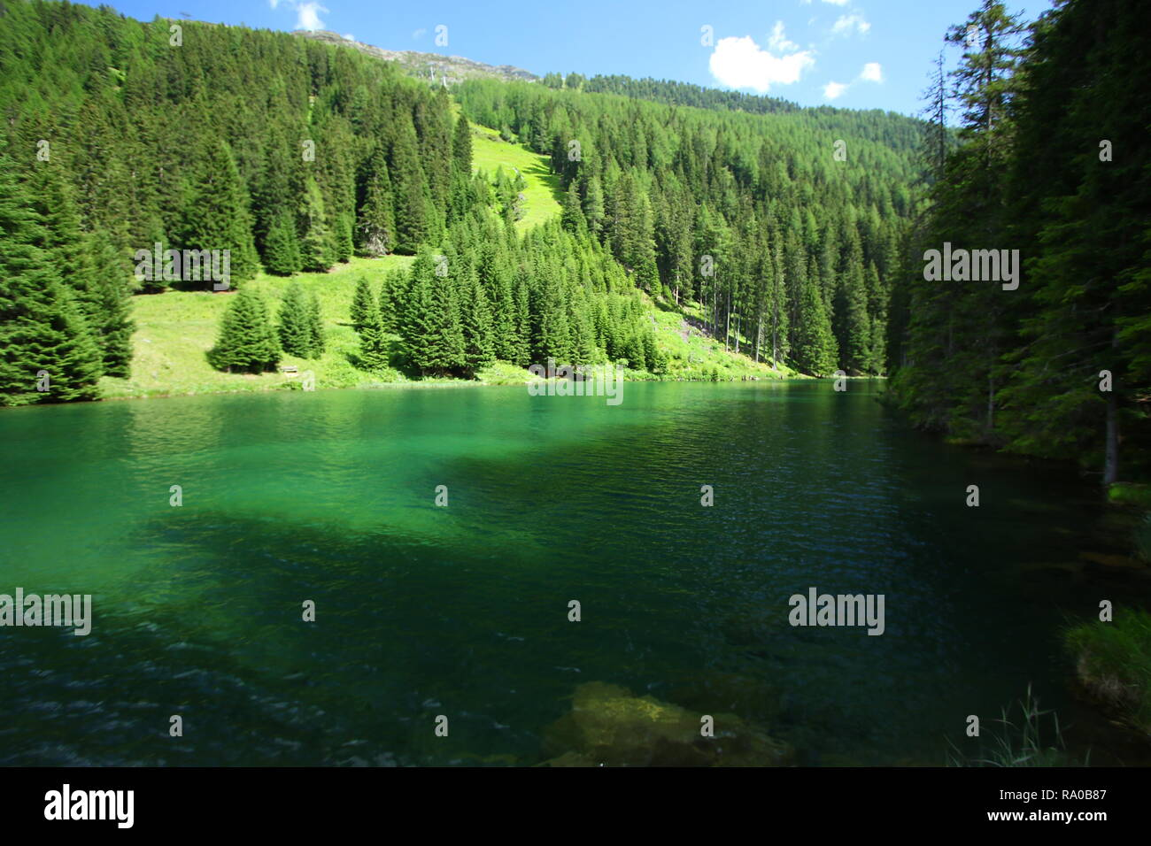 The Schwarzwassersee is close to Ischgl in Austria, nice for walk and hike. fishing with permit is good. friends and familiy use the place for picnic. - Stock Image