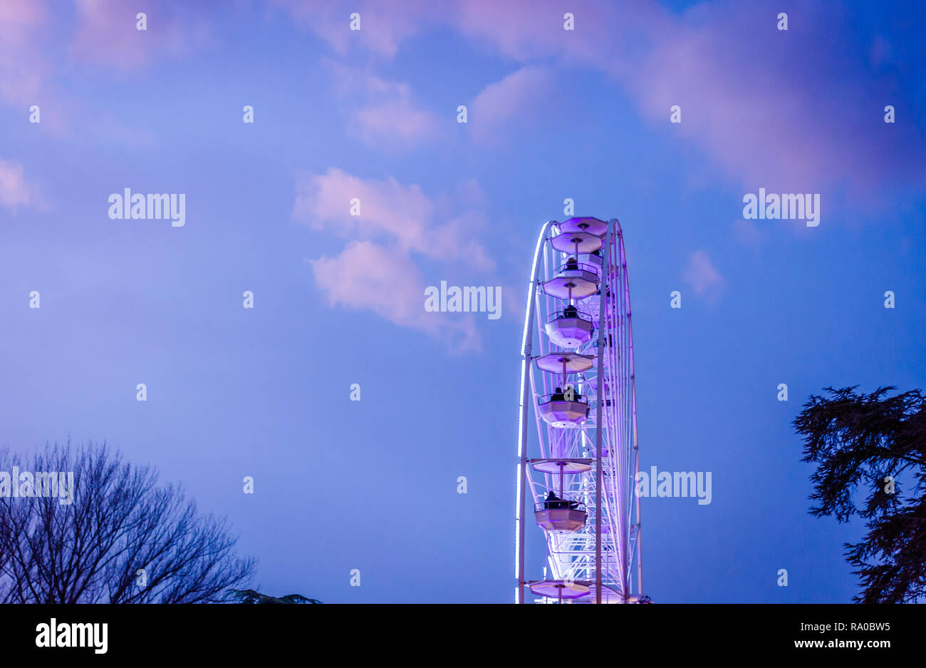 The big ferris wheel on background of sunny blue sky Stock Photo
