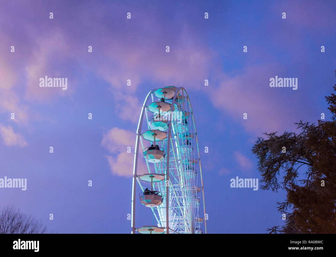 The big ferris wheel on background of sunny blue sky Stock Photo