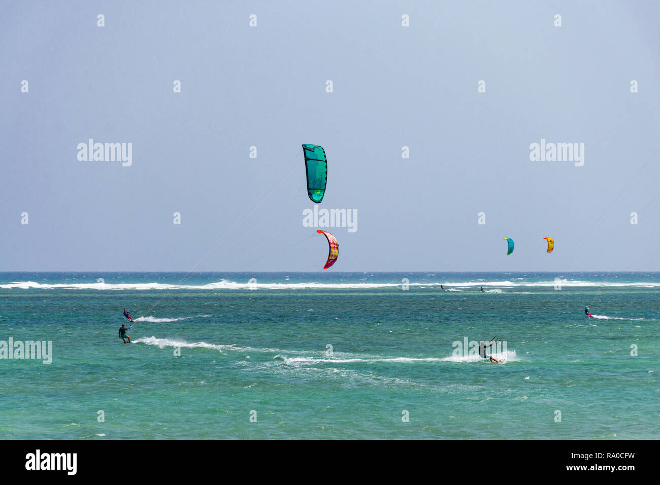 Several kitesurfers on the Indian ocean at Diani on a sunny day, Kenya - Stock Image