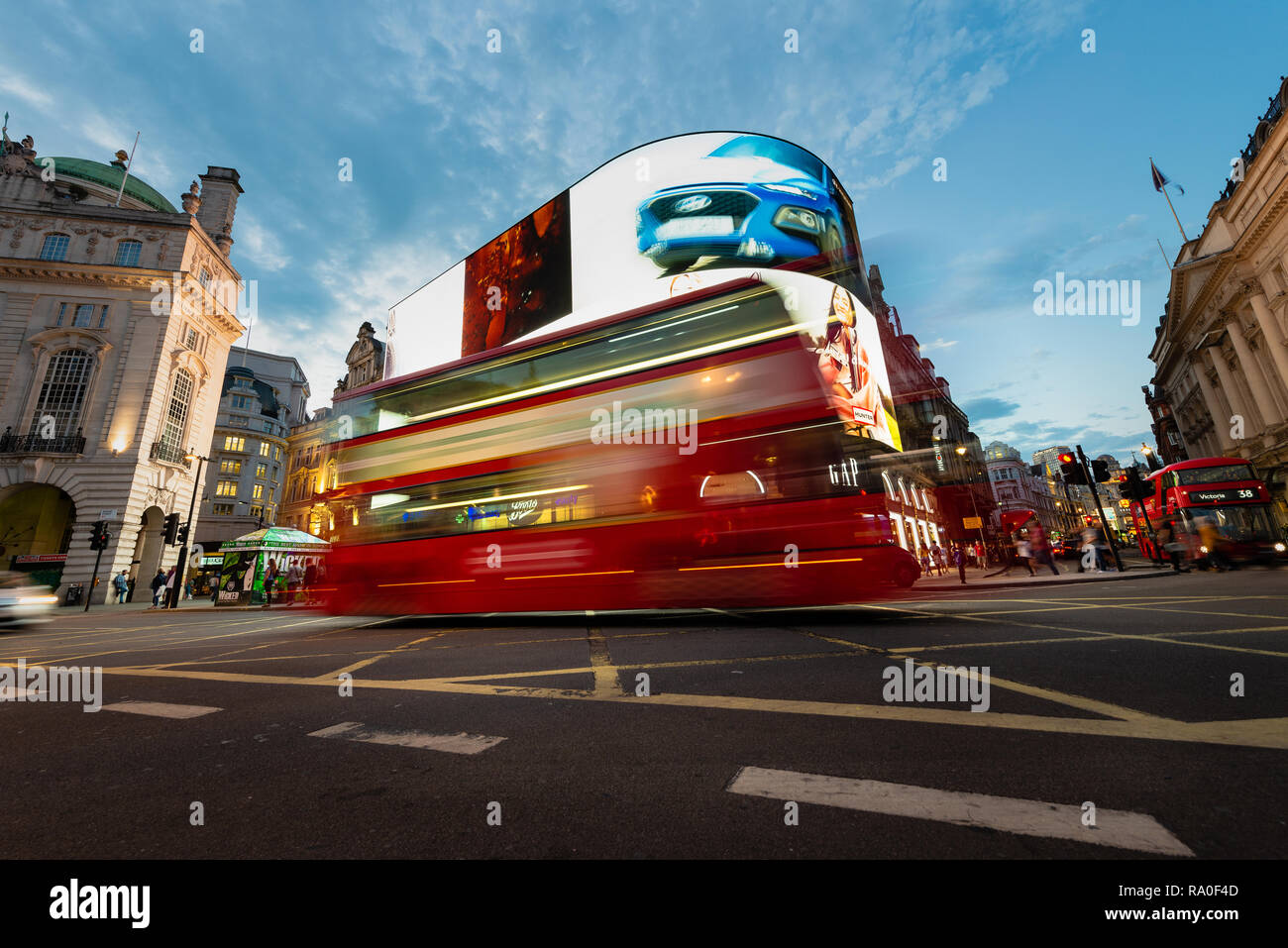 London bus in Picadilly Circus at night - Stock Image