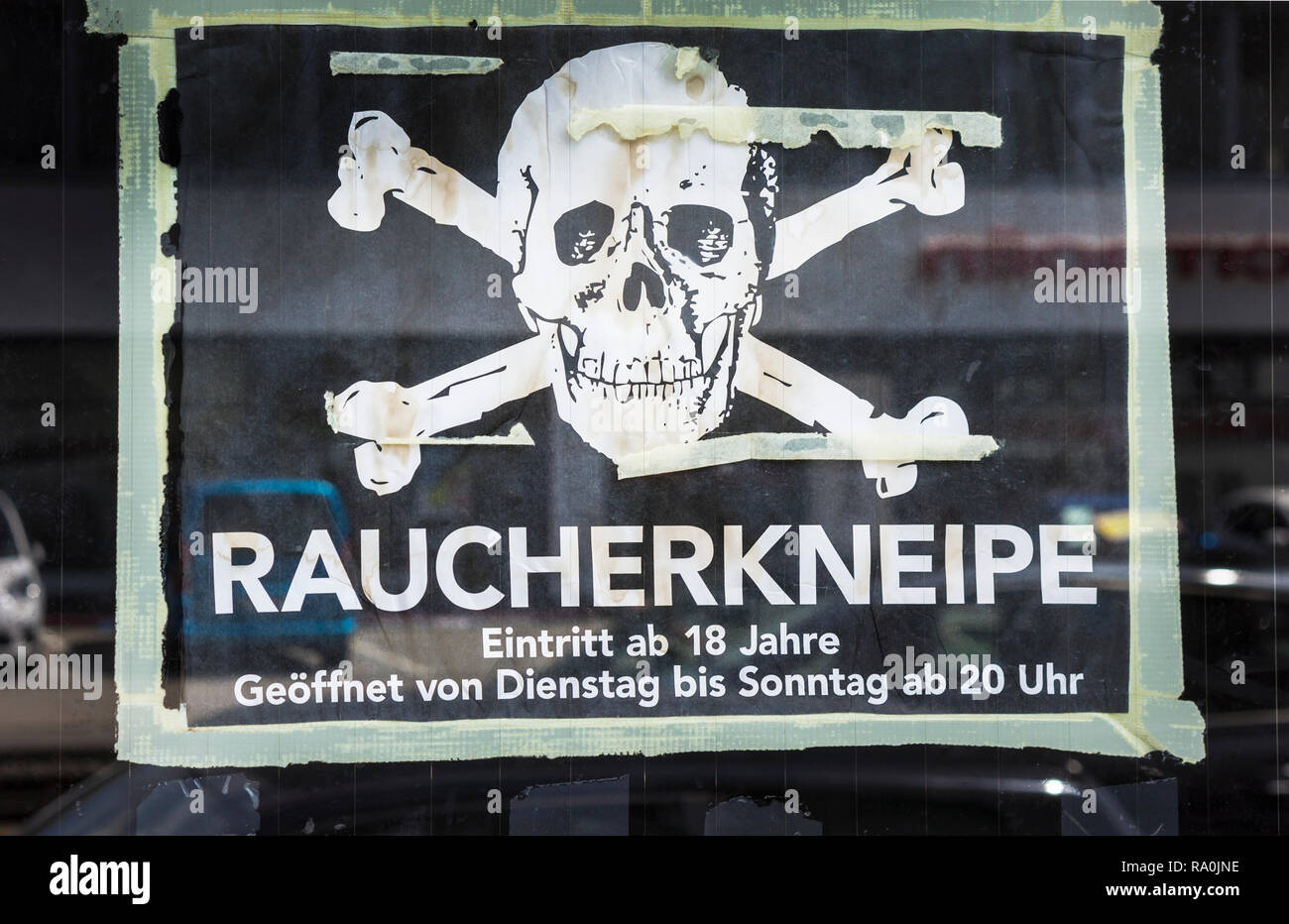 sign  displaying a skull and crossbones,  text reads:  ' smoker´s pub',, - Stock Image