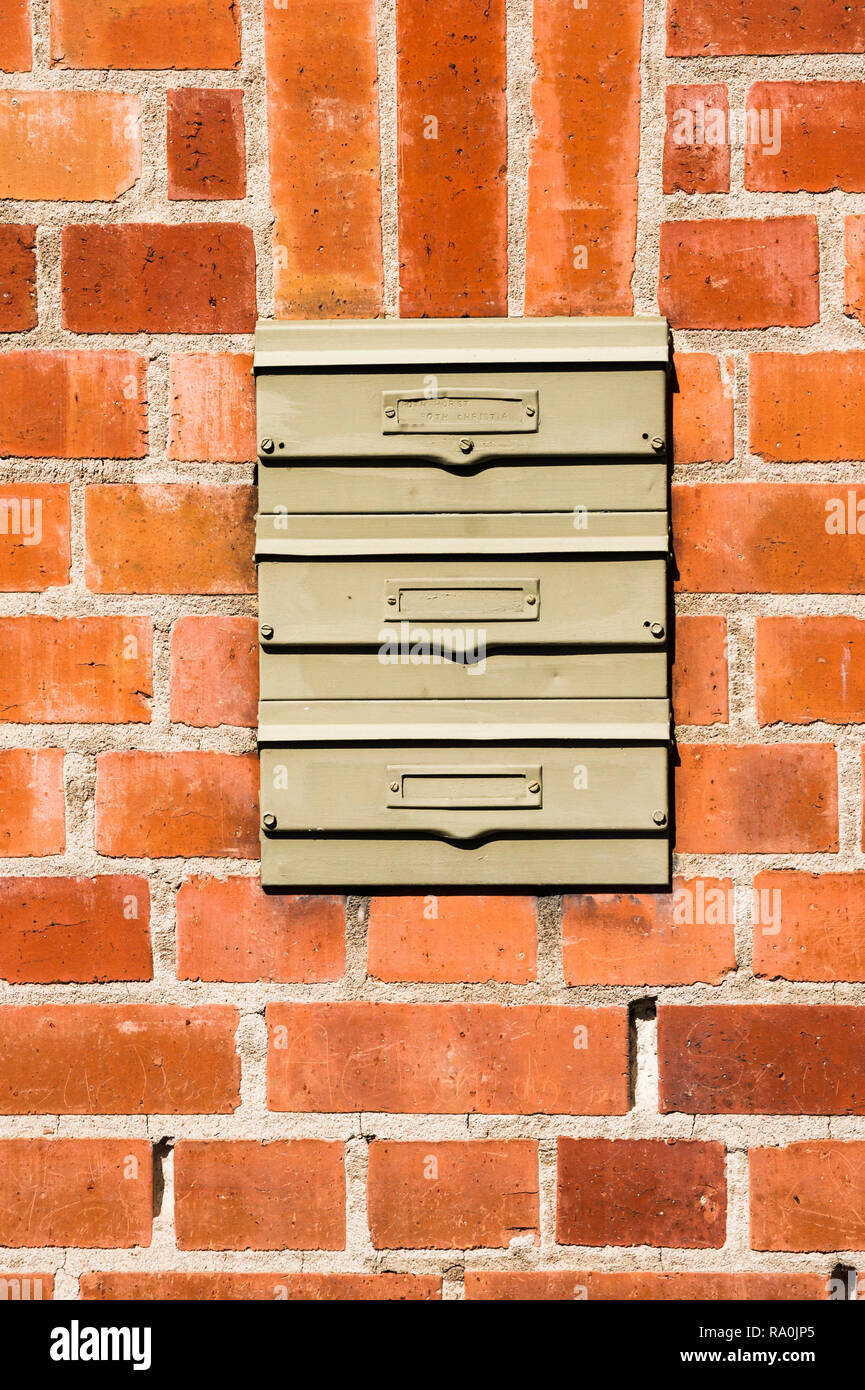 brick wall with three letterboxes without names, Stock Photo