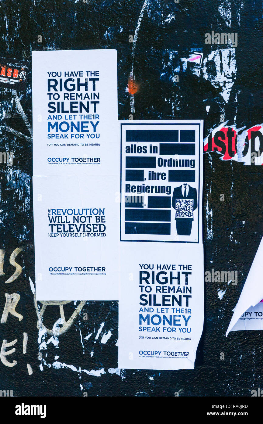 posters by the occupy movement, text reads: _you have the right to remain silent and let their money speak for you, everything is allright, your gover - Stock Image