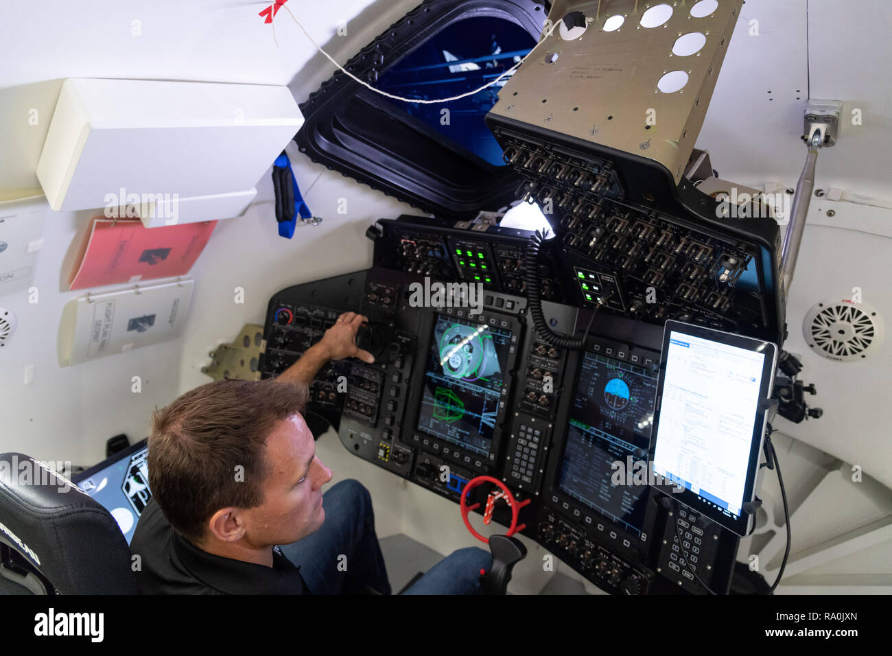 NASA commercial crew astronauts Josh Cassada trains in a simulator