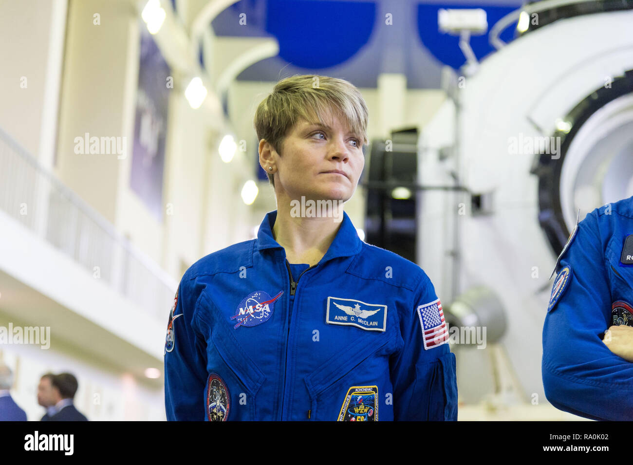 International Space Station Expedition 58 crew member Anne McClain of NASA listens to a reporters questions at the Gagarin Cosmonaut Training Center November 13, 2018 in Star City, Russia. Expedition 58 crew are scheduled to launch December 3rd from the Baikonur Cosmodrome in Kazakhstan for a six-and-a-half month mission on the International Space Station. - Stock Image