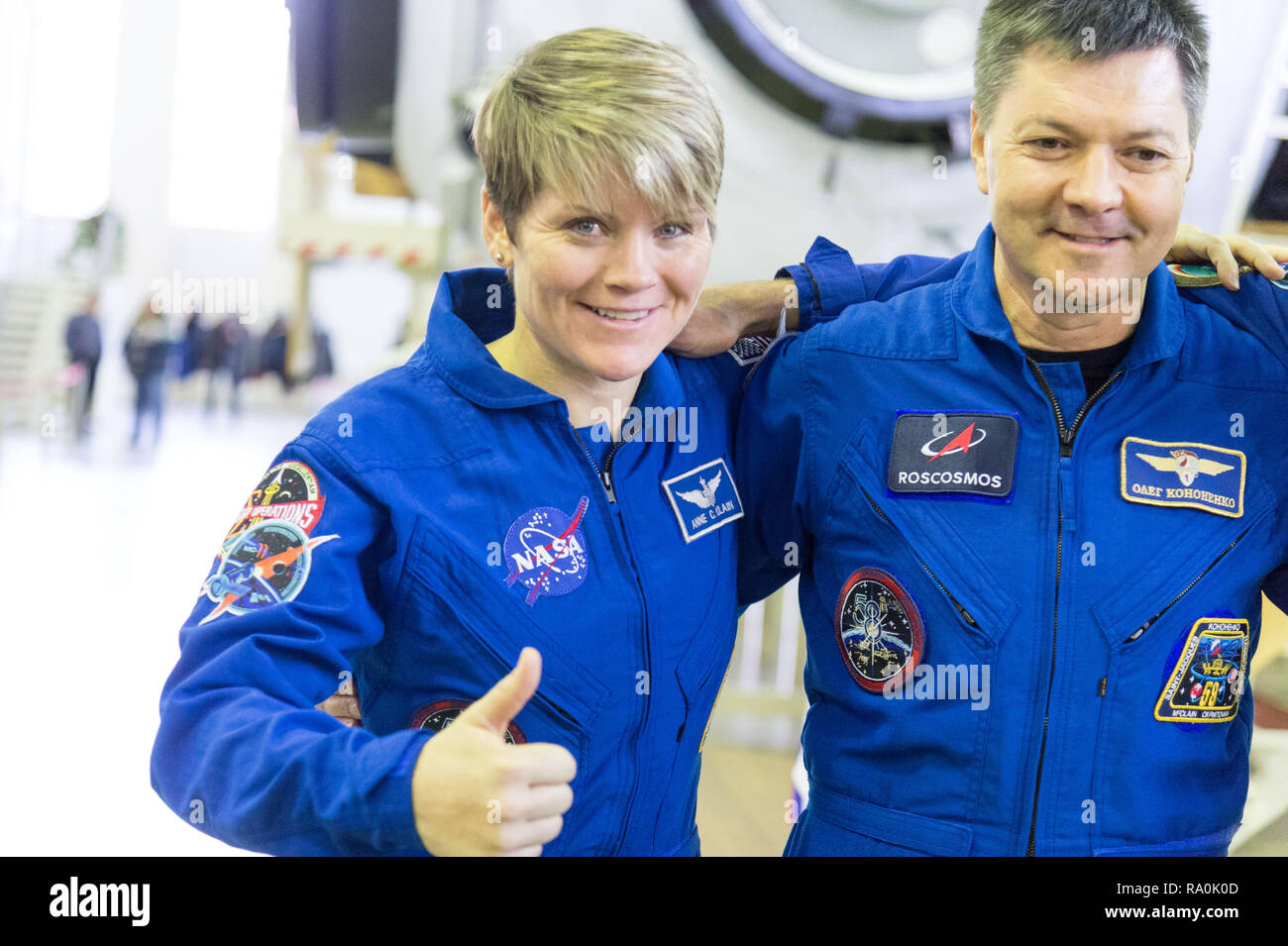 International Space Station Expedition 58 crew member Anne McClain of NASA and Oleg Kononenko of Roscosmos pose for photographers at the Gagarin Cosmonaut Training Center November 13, 2018 in Star City, Russia. Expedition 58 crew are scheduled to launch December 3rd from the Baikonur Cosmodrome in Kazakhstan for a six-and-a-half month mission on the International Space Station. - Stock Image