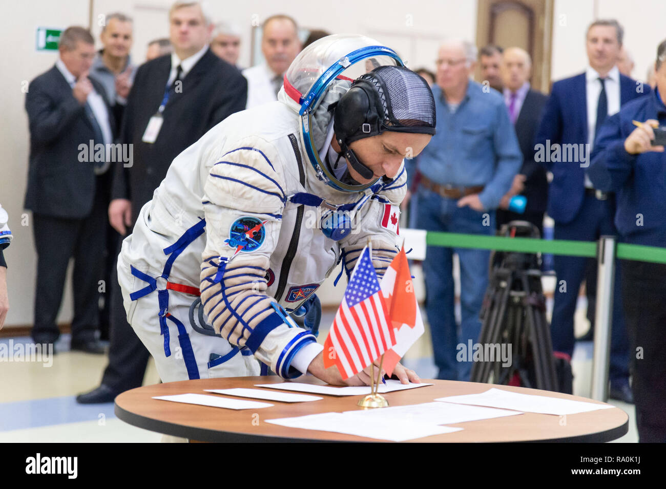 International Space Station Expedition 58 crew member David Saint-Jacques of the Canadian Space Agency signs in for the final day of qualification exams at the Gagarin Cosmonaut Training Center November 14, 2018 in Star City, Russia. The three are scheduled to launch December 3rd from the Baikonur Cosmodrome in Kazakhstan for a six-and-a-half month mission on the International Space Station. - Stock Image
