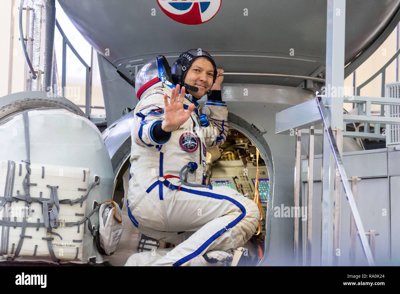 International Space Station Expedition 58 crew member Oleg Kononenko of Roscosmos waves as he enters the Soyuz simulator at the Gagarin Cosmonaut Training Center November 14, 2018 in Star City, Russia. The three are scheduled to launch December 3rd from the Baikonur Cosmodrome in Kazakhstan for a six-and-a-half month mission on the International Space Station. - Stock Image