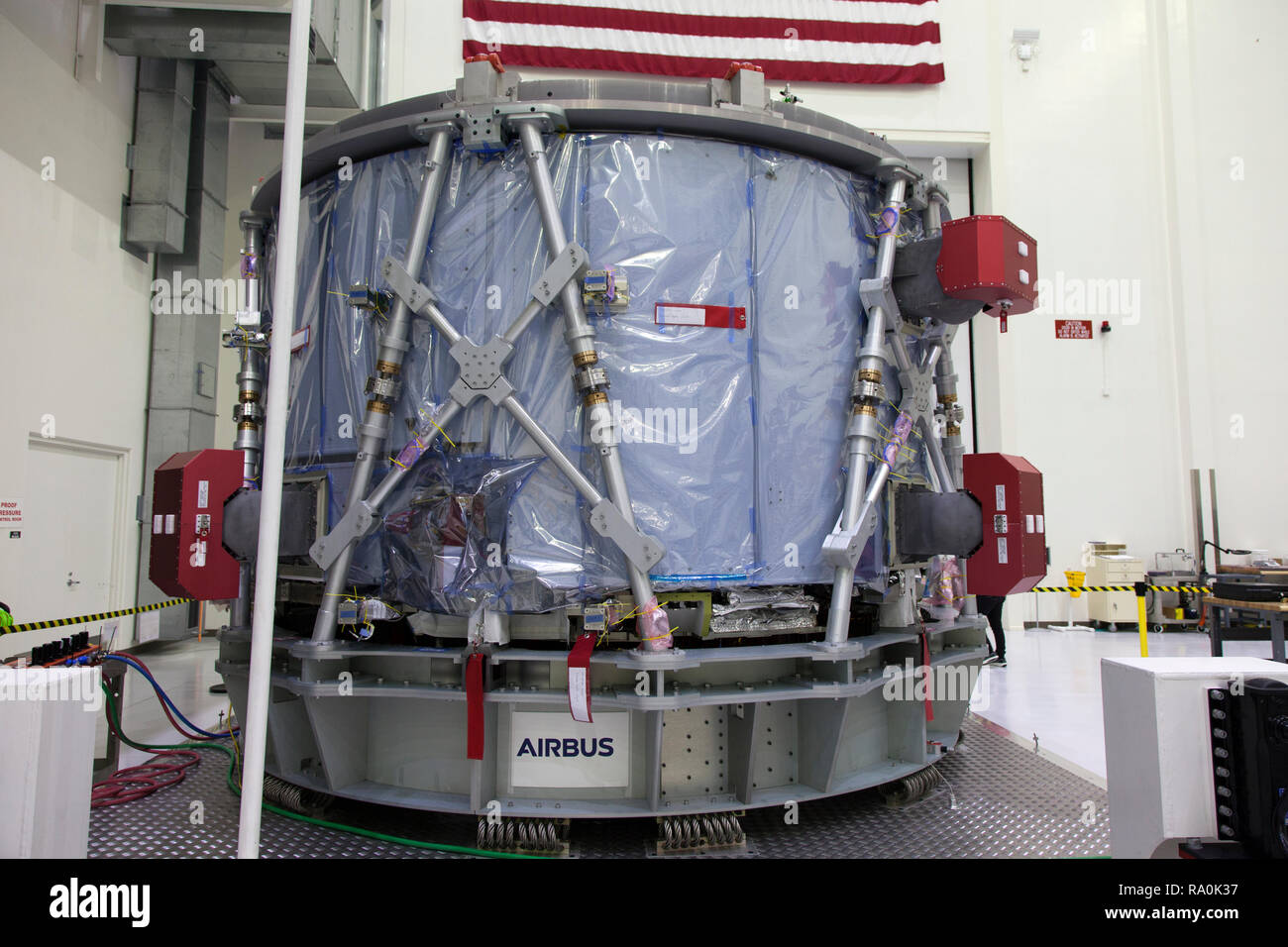 The European Service Module is unpacked inside the Neil Armstrong Operations and Checkout Building high bay at the Kennedy Space Center November 7, 2018 in Cape Canaveral, Florida. The ESM is provided by the European Space Agency, and built by Airbus Defence and Space. It will supply the main propulsion system and power to the Orion spacecraft for Exploration Mission-1, a mission around the Moon. The ESM also will house air and water for astronauts on future missions. EM-1 will be an uncrewed flight test that will provide a foundation for human deep space exploration to destinations beyond Ear - Stock Image