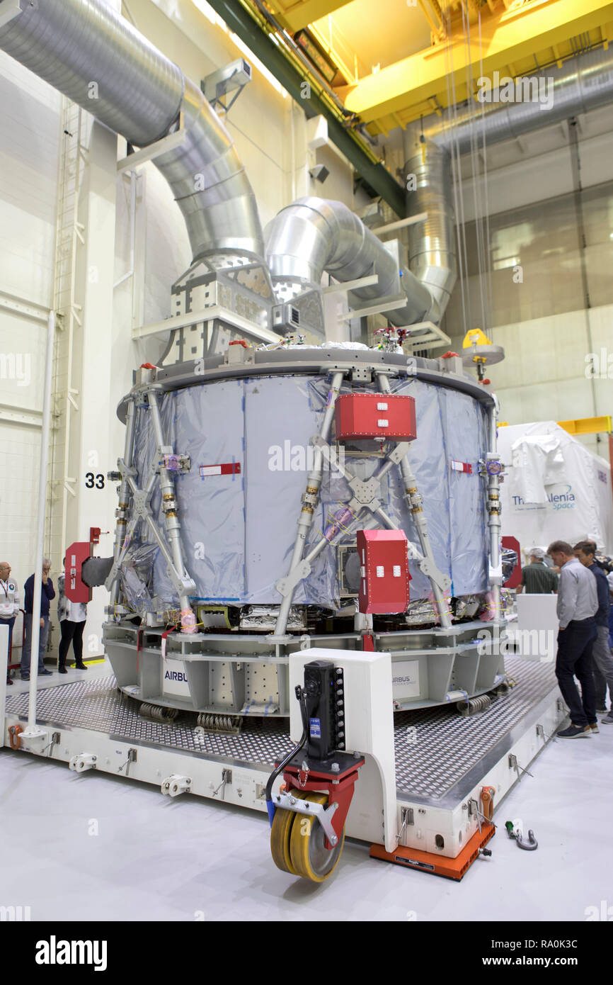 The European Service Module is unpacked inside the Neil Armstrong Operations and Checkout Building high bay at the Kennedy Space Center November 6, 2018 in Cape Canaveral, Florida. The ESM is provided by the European Space Agency, and built by Airbus Defence and Space. It will supply the main propulsion system and power to the Orion spacecraft for Exploration Mission-1, a mission around the Moon. The ESM also will house air and water for astronauts on future missions. EM-1 will be an uncrewed flight test that will provide a foundation for human deep space exploration to destinations beyond Ear - Stock Image