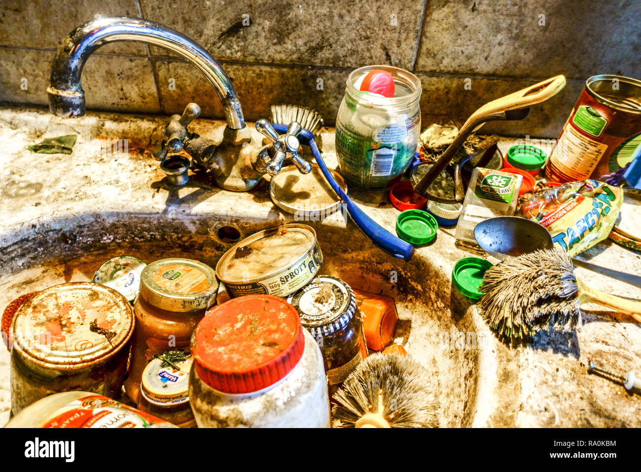 Dirty and unwashed kitchen stuff in the sink - Stock Image
