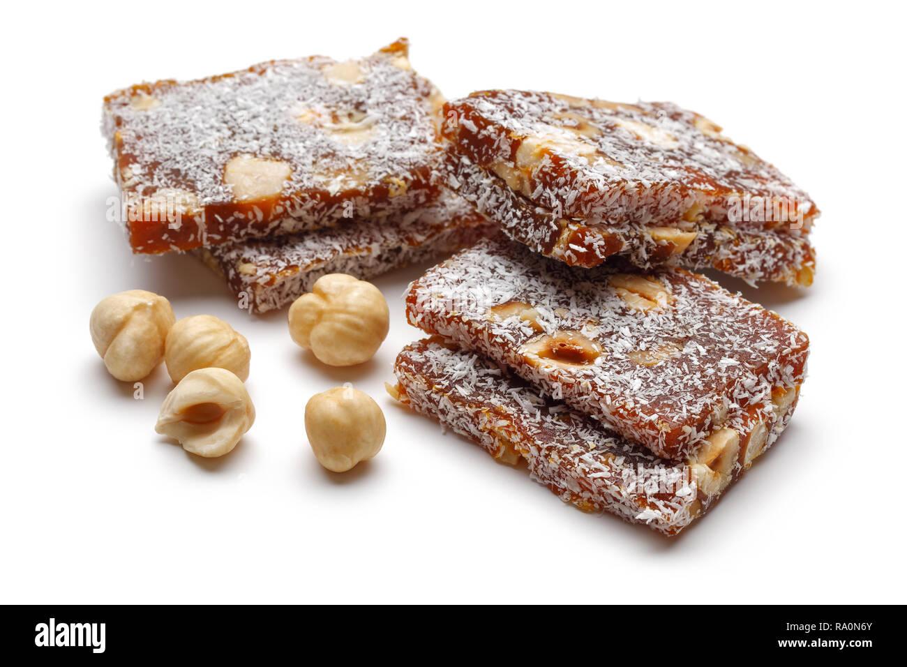 Turkish dessert cezerye with hazelnuts isolated on white background Stock Photo