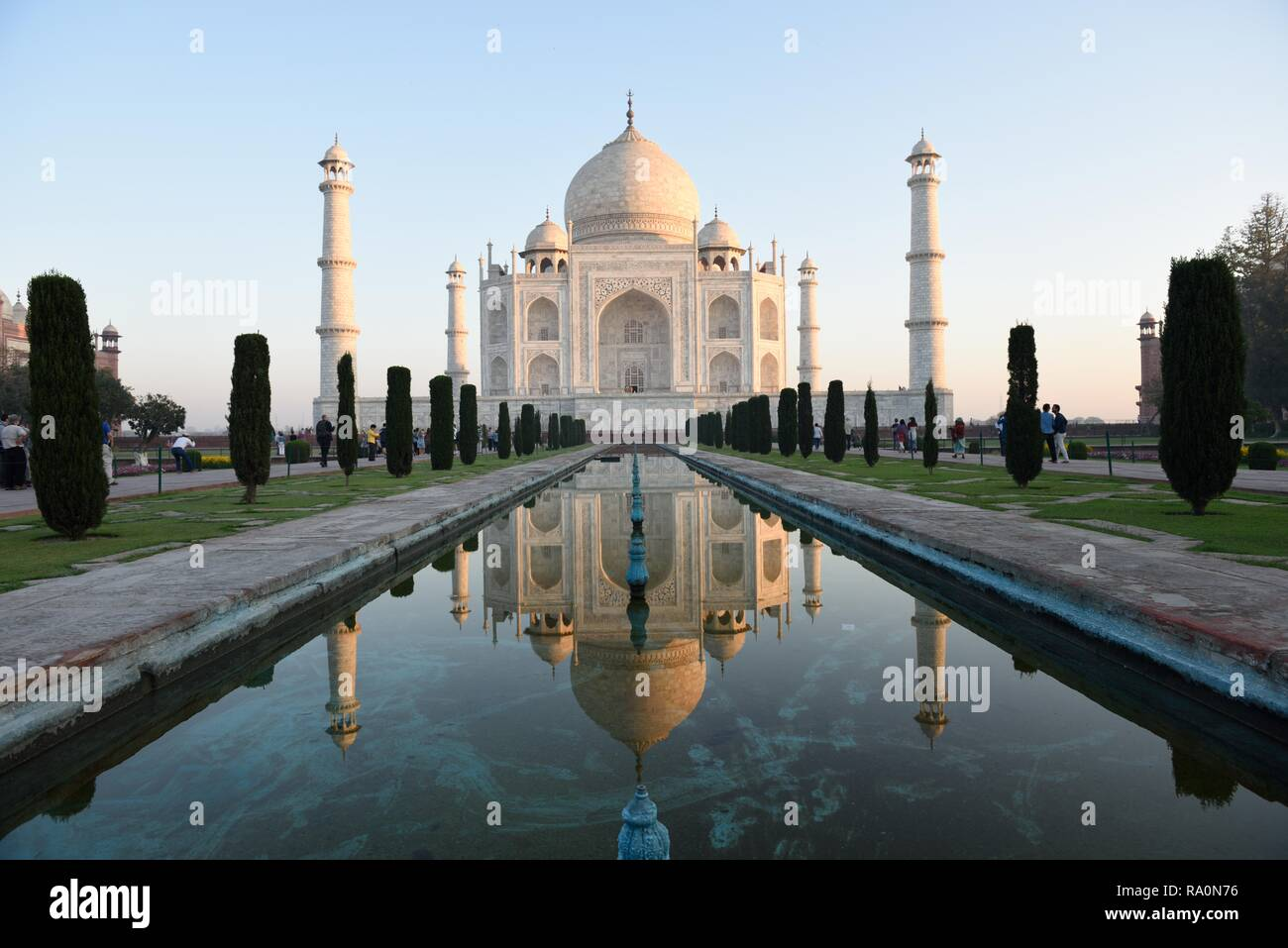 White makrana marble Taj Mahal and water reflections at sunrise in Agra, India. - Stock Image