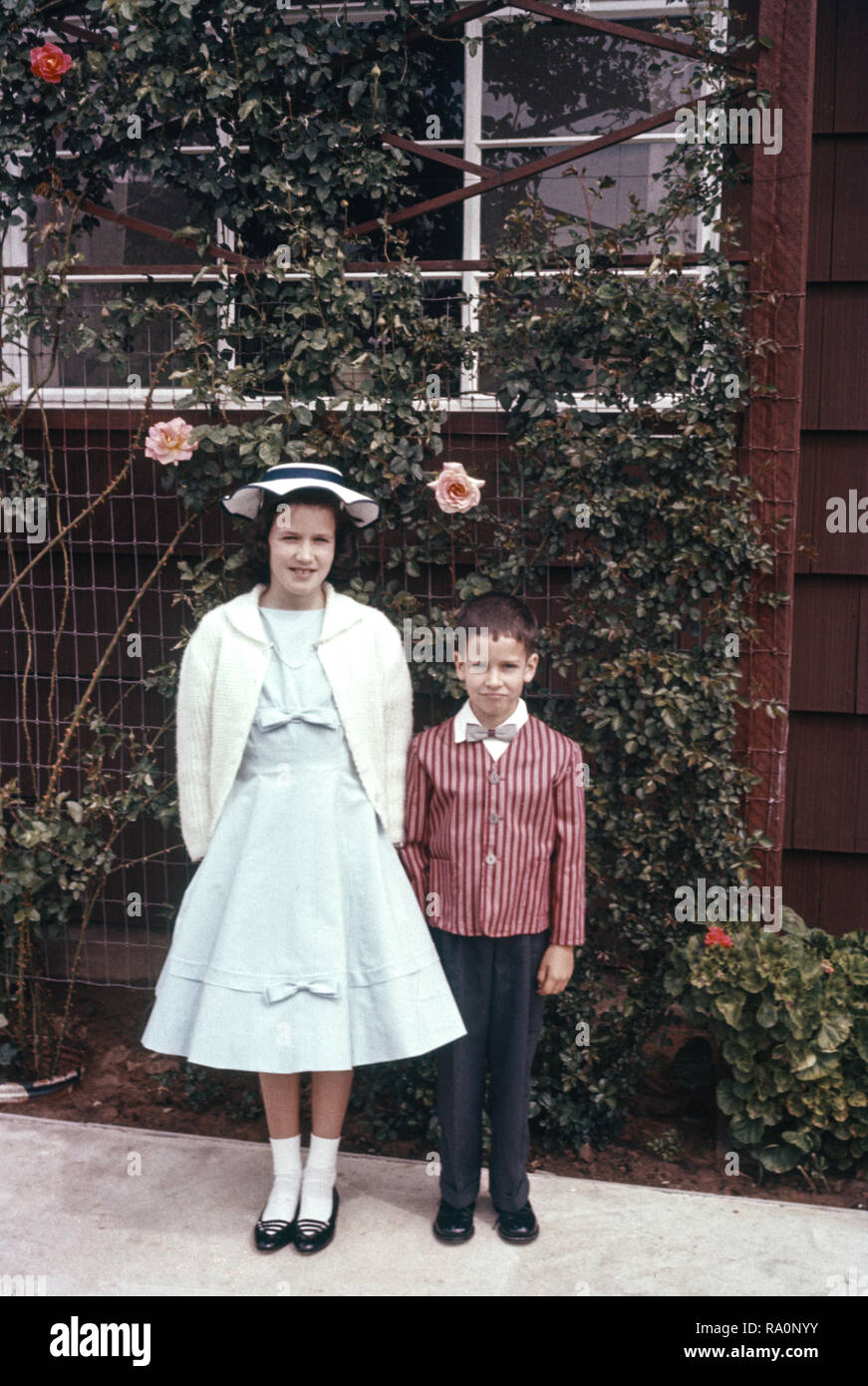 Brother and sister in their Sunday best pose for picture, USA   1960s - Stock Image