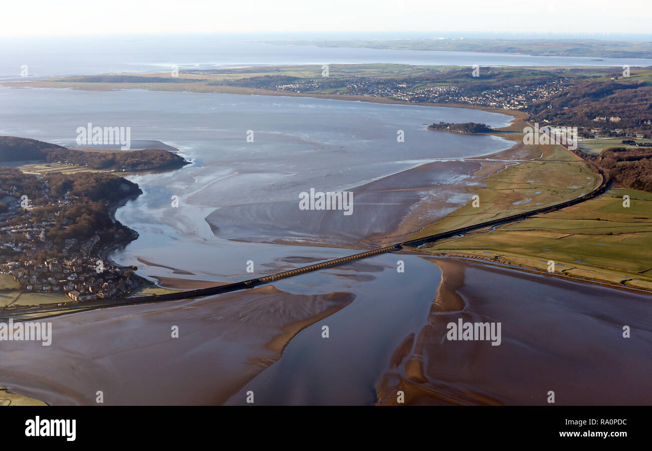 aerial view of the railway line at Arnside, Lancashire as it crosses the River Kent Estuary coming down from Kendal - Stock Image