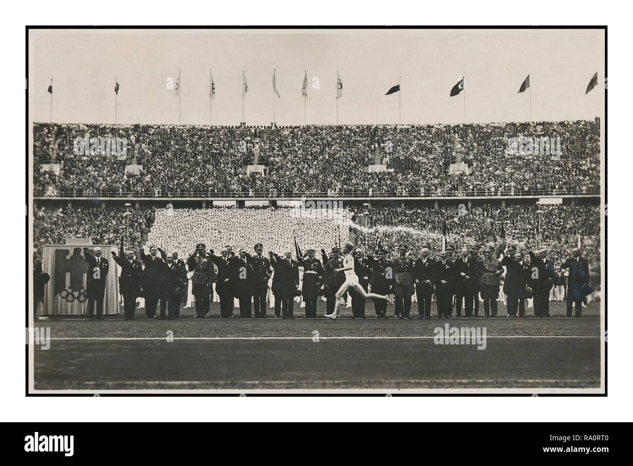 Vintage 1936 Nazi Berlin Germany Olympic Games. German Reich Olympia Postcard 'Torch Relay Runner Arrives at the Stadium', Berlin Olympic Stadium Germany - Stock Image