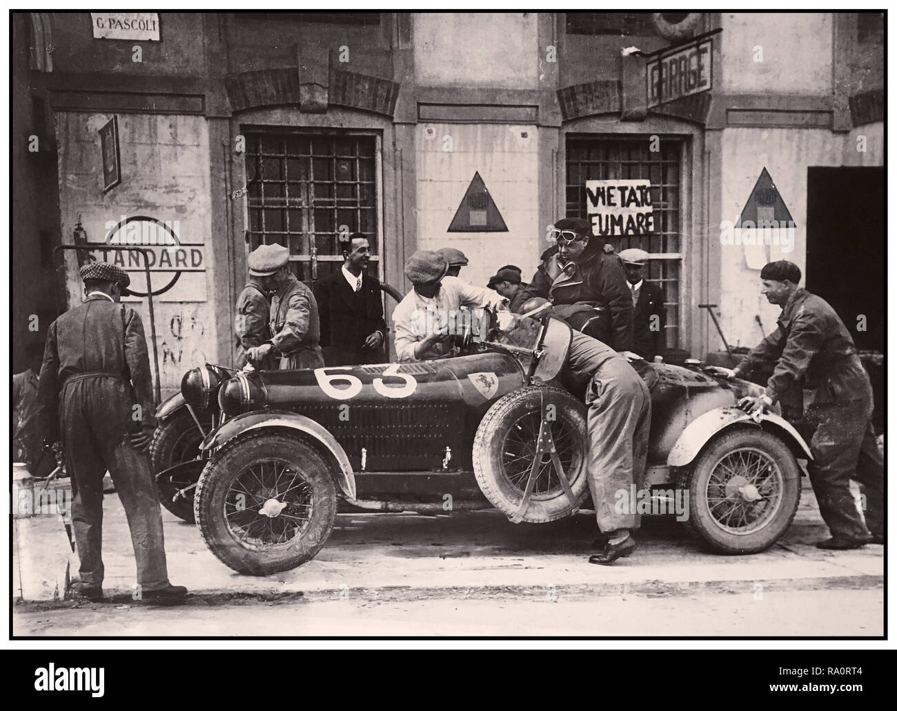 Vintage 1932 Mille Miglia Italian road race, a brief pit stop for Number 63 Alfa Romeo 6C 1500 SStf Spider Zagato entered by Scuderia Ferrari and finished the endurance race in 6th place. The Mille Miglia (1000 Miglia) was an open-road, motorsport endurance race which took place in Italy twenty-four times from 1927 to 1957. - Stock Image