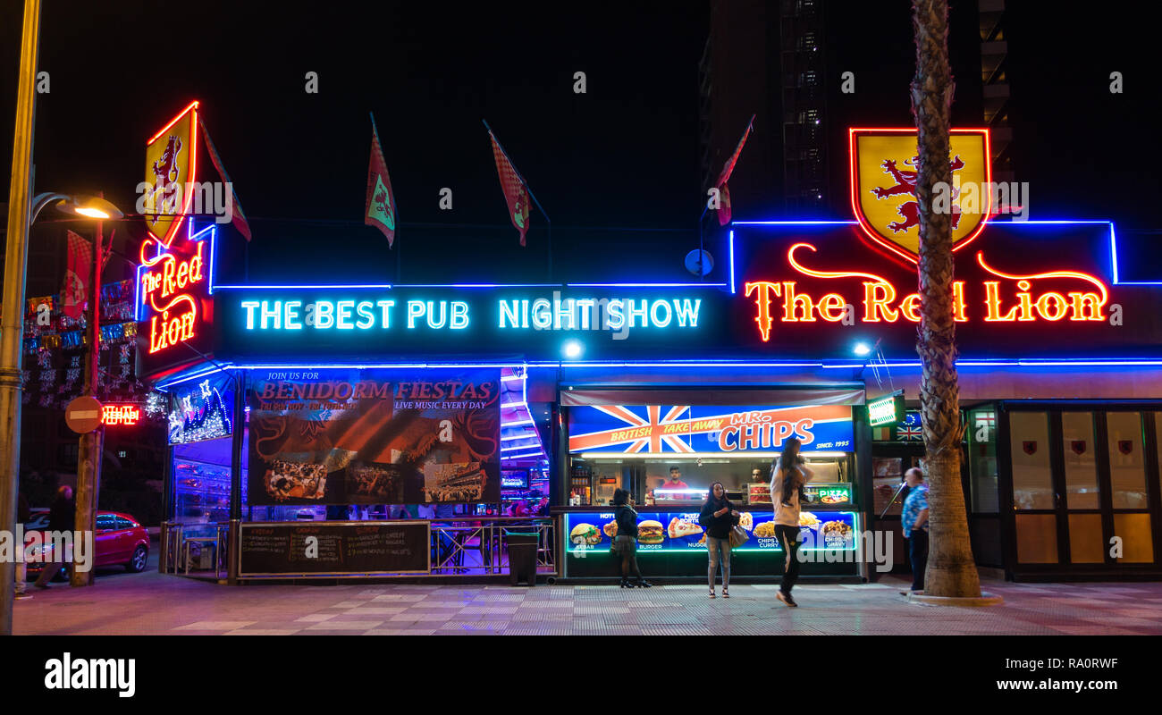The Red Lion Pub in the New Town, Benidorm, Alicante Province, Spain lit up at night. Stock Photo