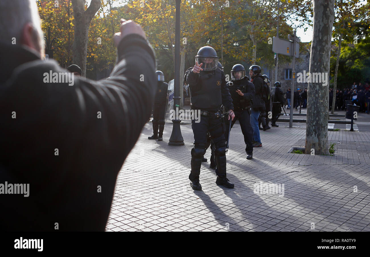 Barcelona / Spain - December 21, 2018: Anti clash riots police charge against demonstrators during the protest against the celebration of the Spanish  - Stock Image