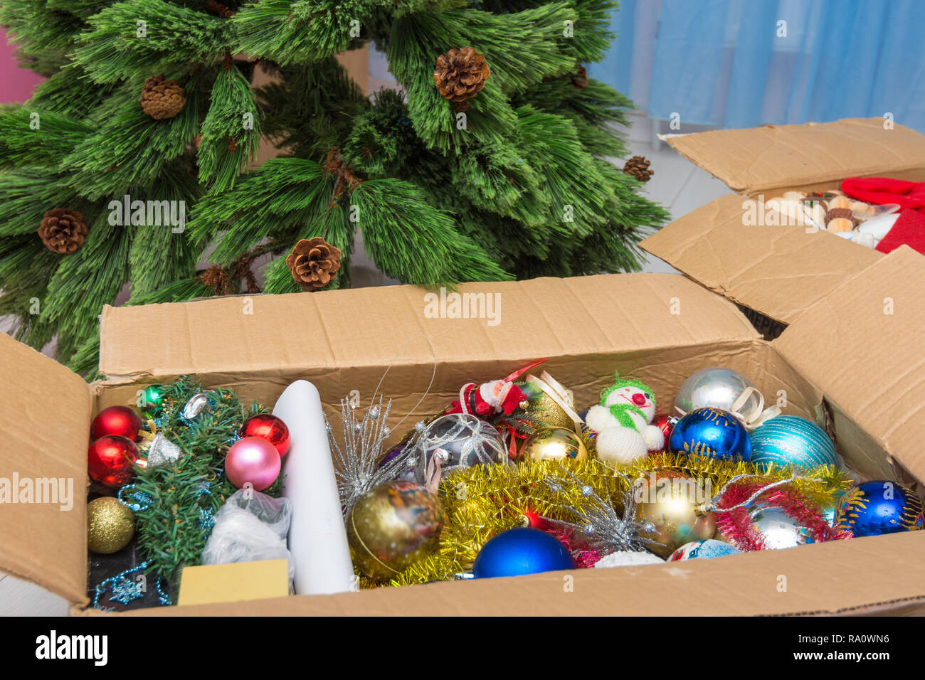 Artificial Christmas Tree Box.Christmas Tree Decorations In A Box In Front Of An