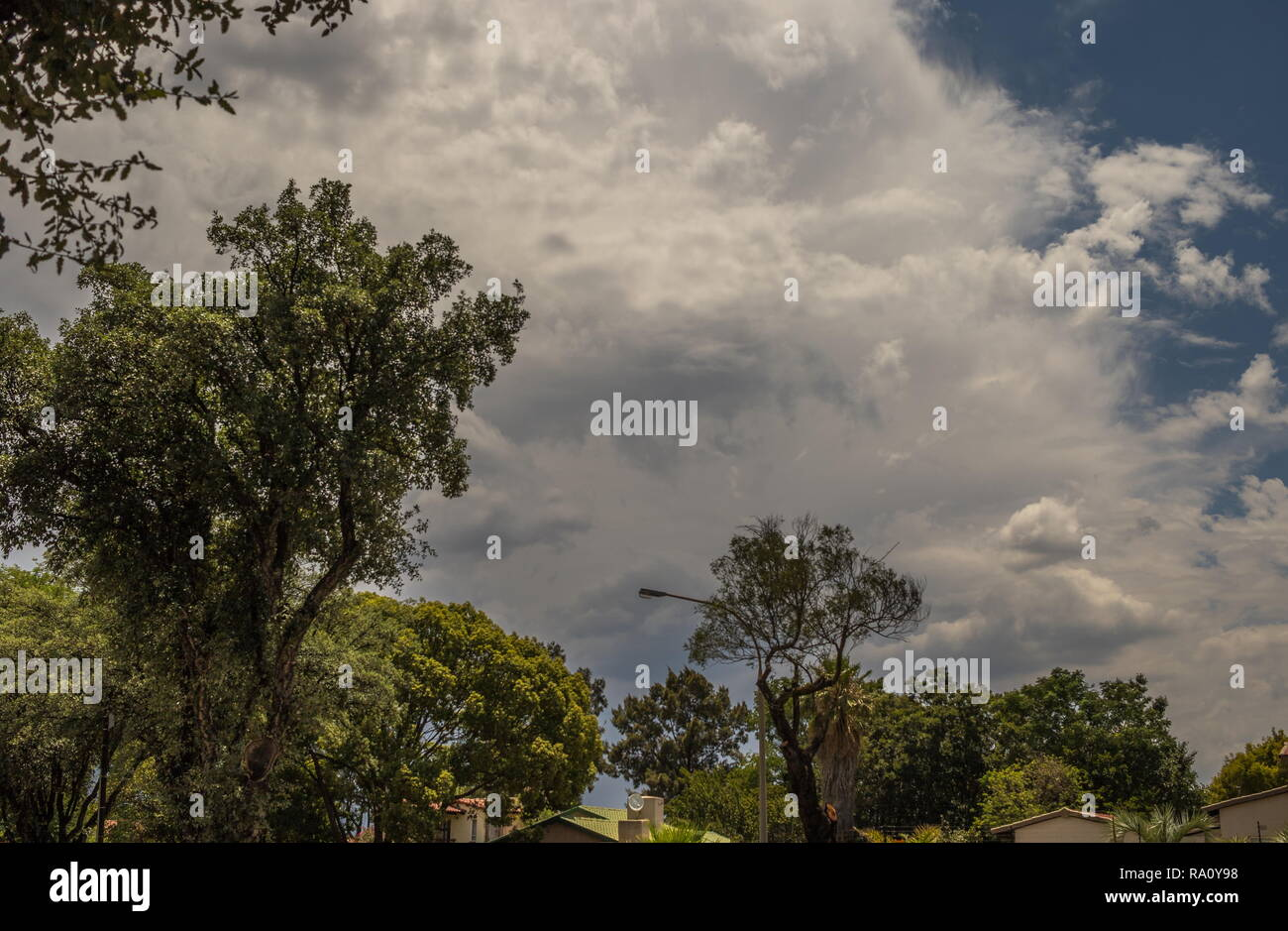 Threatening storm clouds above a residential area in Gauteng, South Africa image in landscape format with copy space - Stock Image