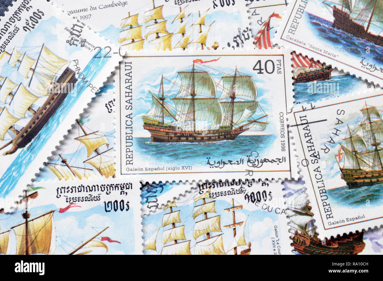 Cancelled postage stamps printed by Republic Sahrawi and Cambodia, that showsancient sailing ships. - Stock Image