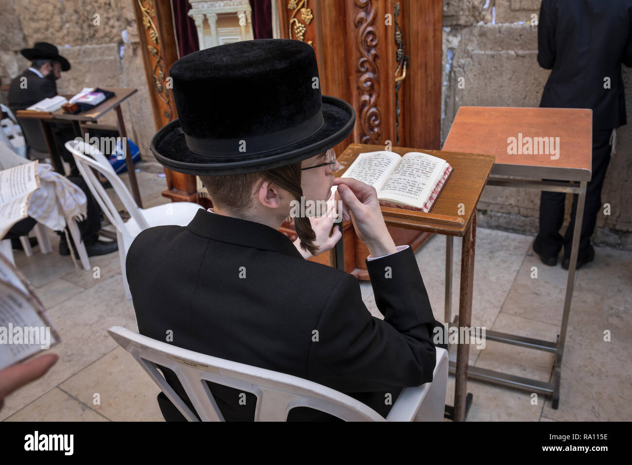 A young Orthodox Jew praying at Western Wall in Jerusalem. Israel - Stock Image