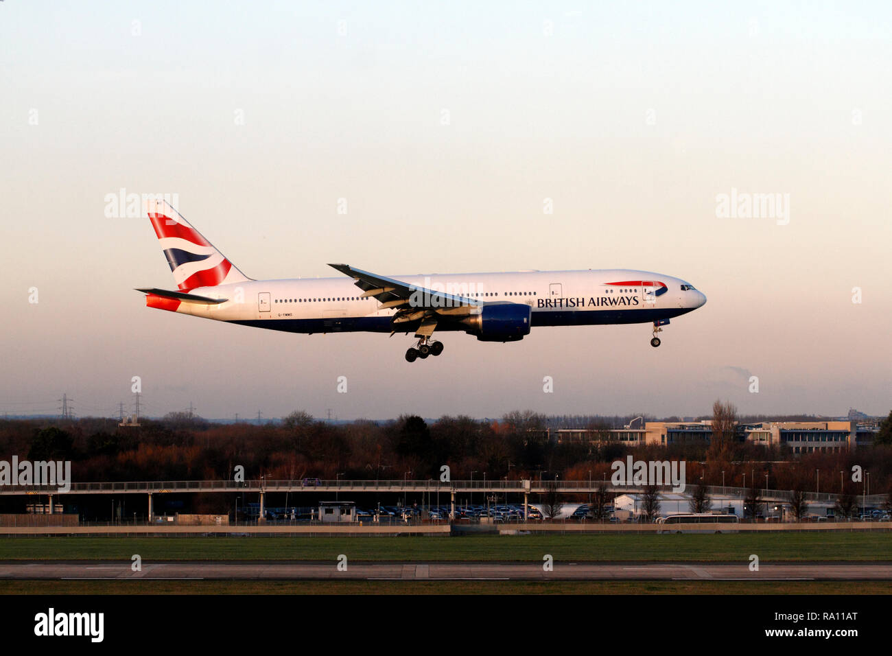 Boeing 777-236 BA, BRITISH AIRWAYS twin-engined turbofan airliner landing at Terminal 5 Heathrow airport, London UK. - Stock Image
